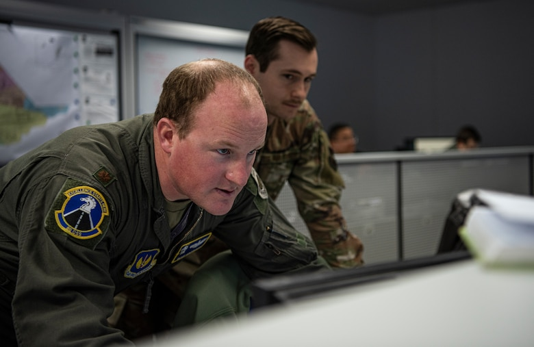 U.S. Air Force Maj. David Mackintosh, 86th Operations Support Squadron, studies information during an Operational Planning Team meeting March 24, 2020.
