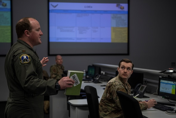 U.S. Air Force Maj. David Mackintosh, 86th Operations Support Squadron chief of weapons and tactics and lead Operational Planning Team planner, briefs the OPT at Ramstein Air Base, Germany, March 24, 2020.