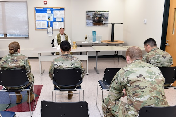 Father Matt Foley, parish pastor for St. James Catholic Church, in Arlington Heights, Illinois, conducts chaplain services for local Soldiers, assigned to the 85th U.S. Army Reserve Support Command, during the unit's battle assembly weekend training, February 9, 2020.