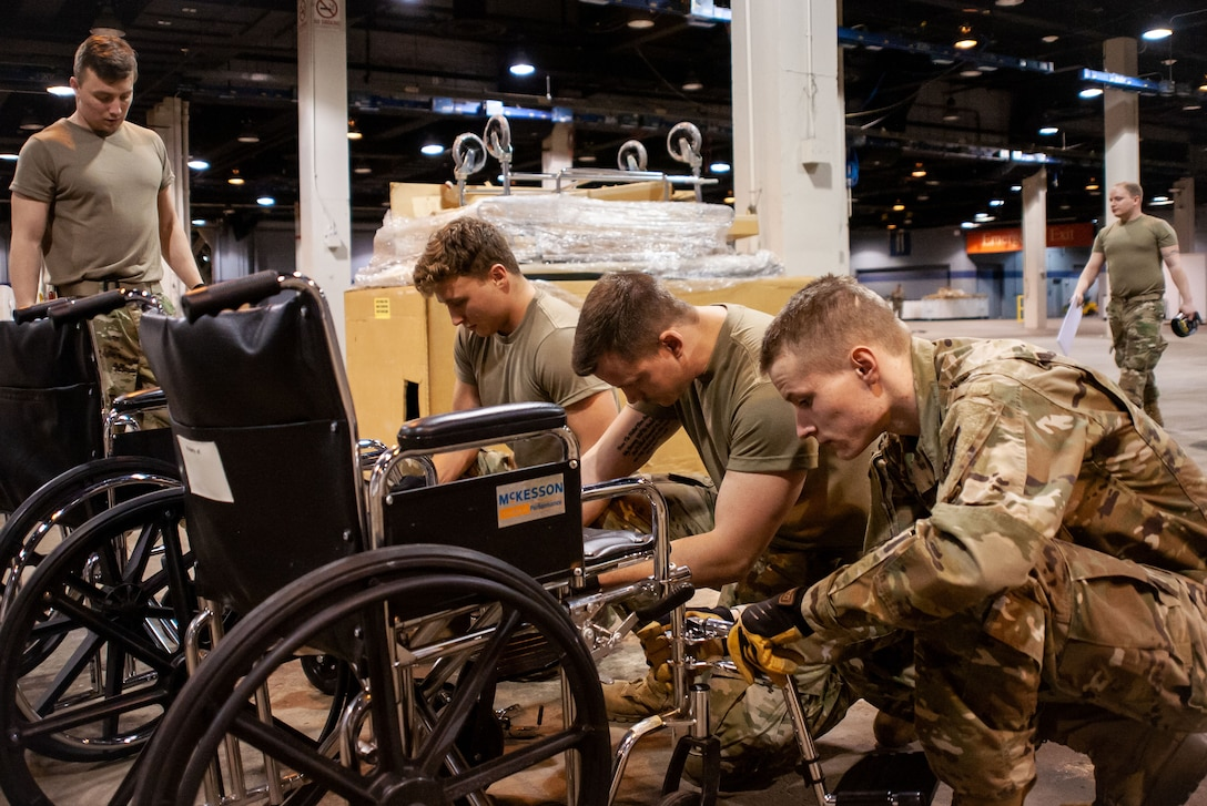 National Guard members assemble medical equipment.