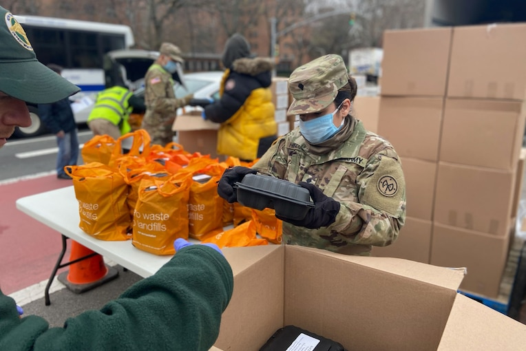 A soldiers packs reusable bags