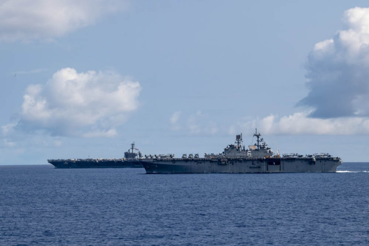 Two Navy ships sail in the Philippine Sea.