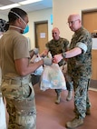 Marines from MARFORK distribute care packages for Marines.