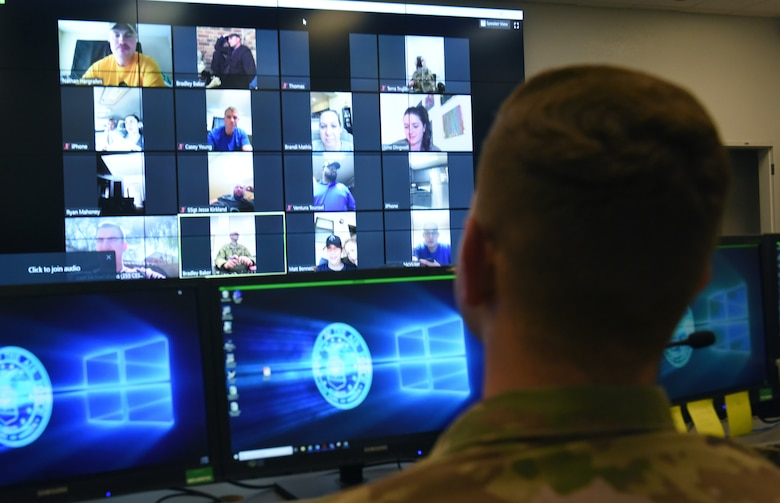 A photo of a computer screen with Air Force members video chatting