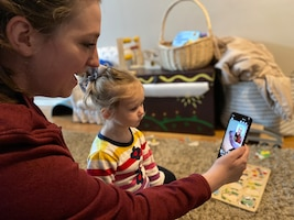 Danielle Frank, a military spouse, uses video conferencing technology to stay in contact with family during the COVID-19 quarantine, Gresham, Oregon, March 27, 2020. Staying connected while practicing social distancing is crucial to the mental well-being of Airmen and their families.