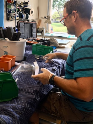 U.S. Coast Guard Chief Petty Officer Bob McCormick, U.S. Coast Guard Cutter Joseph Gerczak operations chief, creates face shields for medical professionals in Hawaii, while practicing social distancing. According to the Center for Disease Control, face shields help prevent large-particle droplets, splashes, sprays or splatter that may contain germs from reaching the mouth and nose of the person wearing the shield. (Courtesy photo)