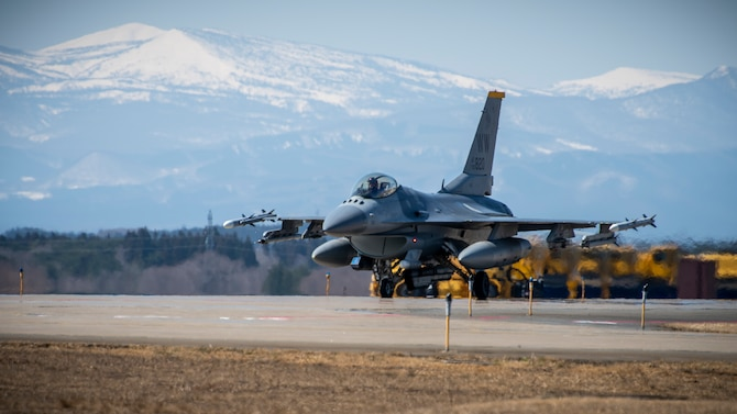 A U.S. Air Force F-16 Fighting Falcon taxis down the runway at Misawa Air Base, Japan, March 30, 2020. In an air-to-surface role, the F-16 can fly more than 500 miles, deliver its weapons with superior accuracy, defend itself against enemy aircraft, and return to its starting point. This F-16 belongs to the 14th Fighter Squadron, assigned to Misawa AB in 1994. Their emblem is the Fighting Samurai. (U.S. Air Force photo by Airman 1st Class China M. Shock)