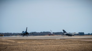 Two U.S. Air Force F-16 Fighting Falcons taxi down the runway at Misawa Air Base, Japan, March 30, 2020. During Operation Allied Force, U.S. Air Force F-16 Fighting Falcon fighters flew a variety of missions, including the suppression of enemy air defense, offensive counter air, defensive counter air, close air support and forward air controller missions. (U.S. Air Force photo by Airman 1st Class China M. Shock)