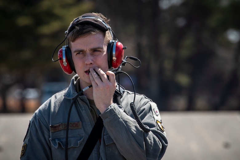 U.S. Air Force Senior Airman Kyle Greyshock, a 13th Fighter Squadron avionics systems journeyman, speaks into a radio headset at Misawa Air Base, Japan, March 30, 2020. Avionics specialists require attention to detail since proper maintenance can mean the difference between mission success and failure. Part of their job consists of helping make quick fixes to jets to ensure they are available for flight. (U.S. Air Force photo by Airman 1st Class China M. Shock)