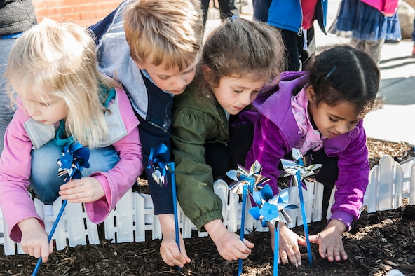 Children plant pinwheels
