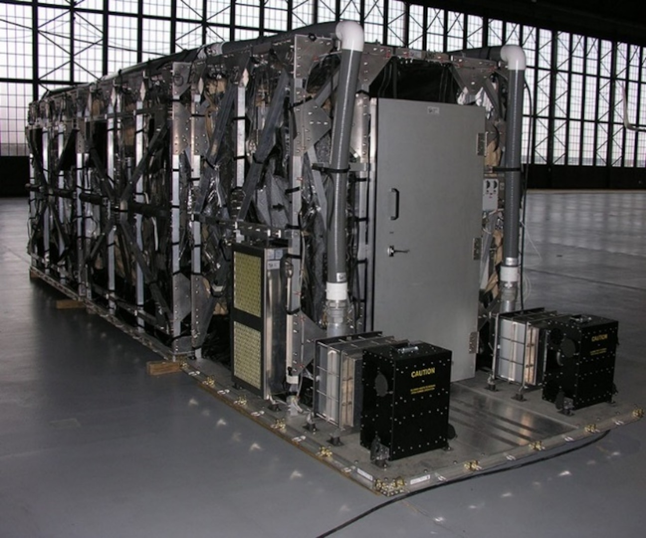 The Transport Isolation System (TIS) is an infectious disease containment unit designed to minimize risk to aircrew, medical attendants, and the airframe, while allowing medical care to be provided to patients in-flight.