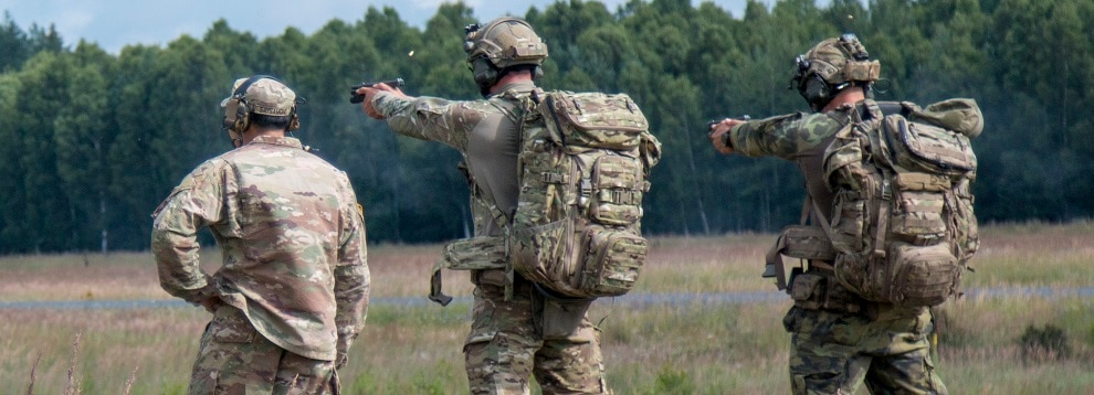 A Czech sniper and his spotter engage targets with pistols during the stress shoot event at the European Best Sniper Team Competition while a grader observes in Grafenwoerh, Germany, July 21, 2019. The European Best Sniper Team Competition is a U.S. Army Europe-directed/7th Army Training Command (7ATC)-hosted contest of skill that includes 17 participating NATO allies and partner nations at 7ATC's Grafenwoehr Training Area, July 20-26. The 2019 European Best Sniper Team Competition is designed to improve professionalism and enhance esprit de corps. (U.S. Army photo by Spc. Ryan Barnes)