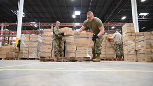 U.S. Air Force Tech. Sgt. Bradly Tuthill, left, and U.S. Air Force Master Sgt. Richard Malloy, ground transportation specialists with the 175th Logistics Readiness Squadron, Maryland Air National Guard, prepare and load boxes of medical supplies and equipment March 19, 2020, at the Maryland Strategic National Stockpile. The Maryland Guard has shipped more than 1 million items to health care workers and hospitals across the state.