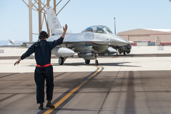 An F-16 Fighting Falcon assigned to the 416th Fight Test Squadron taxis after returning a from a test support mission at Edwards Air Force Base, California, April 1. (Air Force photo by Kyle Brasier)