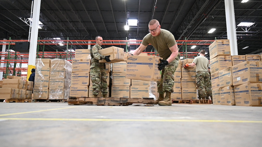 U.S. Air Force Tech. Sgt. Bradly Tuthill, left, and U.S. Air Force Master Sgt. Richard Malloy, ground transportation specialists with the 175th Logistics Readiness Squadron, Maryland Air National Guard, prepare and load boxes of medical supplies and equipment March 19, 2020, at the Maryland Strategic National Stockpile. The Maryland Guard has shipped more than 1 million items to health care workers and hospitals across the state. (U.S Air National Guard photo by Master Sgt. Christopher Schepers)