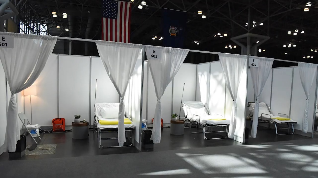 Lt. Gen. Todd Semonite speaks with New York District commander Col. Thomas Asbery on March 27, 2020, about Coronavirus response efforts at New York's Javits Convention Center in coordination with federal, state and local partners.
