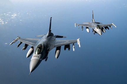 Two U.S. Air Force F-16 Fighting Falcons fly over Afghanistan, March 17, 2020. The F-16 Fighting Falcon is a compact, multi-role fighter aircraft that delivers war- winning airpower to the U.S. Central Command area of responsibility. (U.S. Air Force photo by Tech. Sgt. Matthew Lotz)