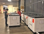Two associates review pallet contents