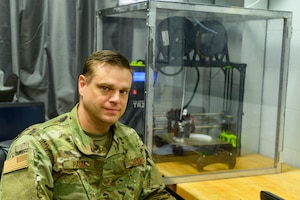 Tech. Sgt. Alan Pasel, an aircraft metals technology specialist assigned to the 130th Maintenance Squadron, with a LulzBot TAZ 6 Dual Platinum 3D printer at McLaughlin Air National Guard Base, Charleston, W.Va., March 27, 2020. Pasel used the printer to design a face shield prototype for production to fulfill a statewide shortage caused by the COVID-19 outbreak.
