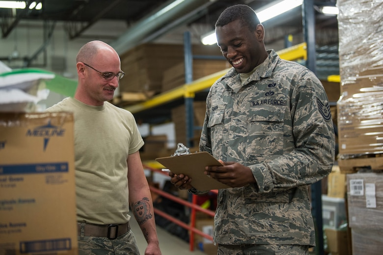 Staff Sgt. Keith Gomo from the Logistics Readiness Squadron and Tech. Sgt. Gladimir Sanon from Civil Engineer Squadron, 158th Fighter Wing, Vermont Air National Guard, assist the Vermont Department of Health with unloading pallets of medical supplies and organizing them for redistribution to strategic locations throughout the state, at a distribution center in Vermont.