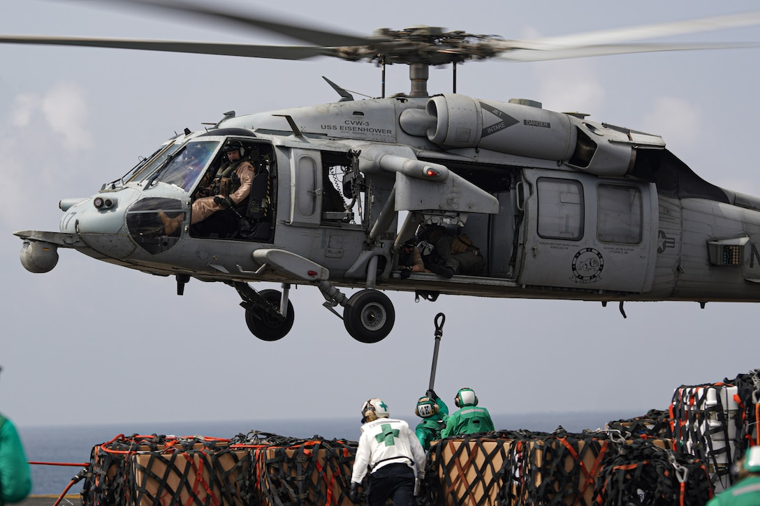 "ARABIAN SEA (April 1, 2020). A MH-60S seahawk attached to the ""Dusty Dogs"" of Helicopter Sea Combat Squadron (HSC) Seven conducts replenish at sea operations between supply ship USNS Robert E. Peary (T-AKE-5) and aircraft carrier USS Dwight D. Eisenhower (CVN69), April 1, 2020.  Ike is deployed to the U.S. 5th Fleet area of operations in support of naval operations to ensure maritime stability and security in the Central Region, connecting the Mediterranean and Pacific through the Western Indian Ocean and three strategic choke points.  (U.S. Navy photo by PR1 (AW/SW) Brandon C. Cole)"