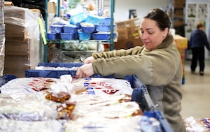 Staff Sgt. Amber Barker, 194th Wing, Washington Air National Guard stakes pallets of bread at the Edgewood Community Food Bank in Edgewood, Wash. on April 2, 2020. Members of the Washington Air and Army National Guard are supporting food banks around the state during the COVID-19 pandemic response.