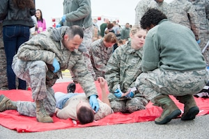 U.S. Air Force Capt. Marc Dunham, 509th Medical Operations Squadron nurse, applies pressure to the neck wound of a simulated patient during a major accident response exercise May 20, 2015, at Whiteman Air Force Base, Mo. Although he typically works in the Personnel Reliability Program clinic, Dunham was part of the response team because major accidents require all medics to work together to treat patients. (U.S. Air Force photo by Staff Sgt. Brigitte N. Brantley/Released)