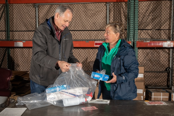 Code 530 Division Head Jimmy Broom (Left) and NNSY's Supply Department (Code 500) Pier Master Jean Heitzman puts together a sanitizing cleaning kit that will be distributed to shops and codes across NNSY.