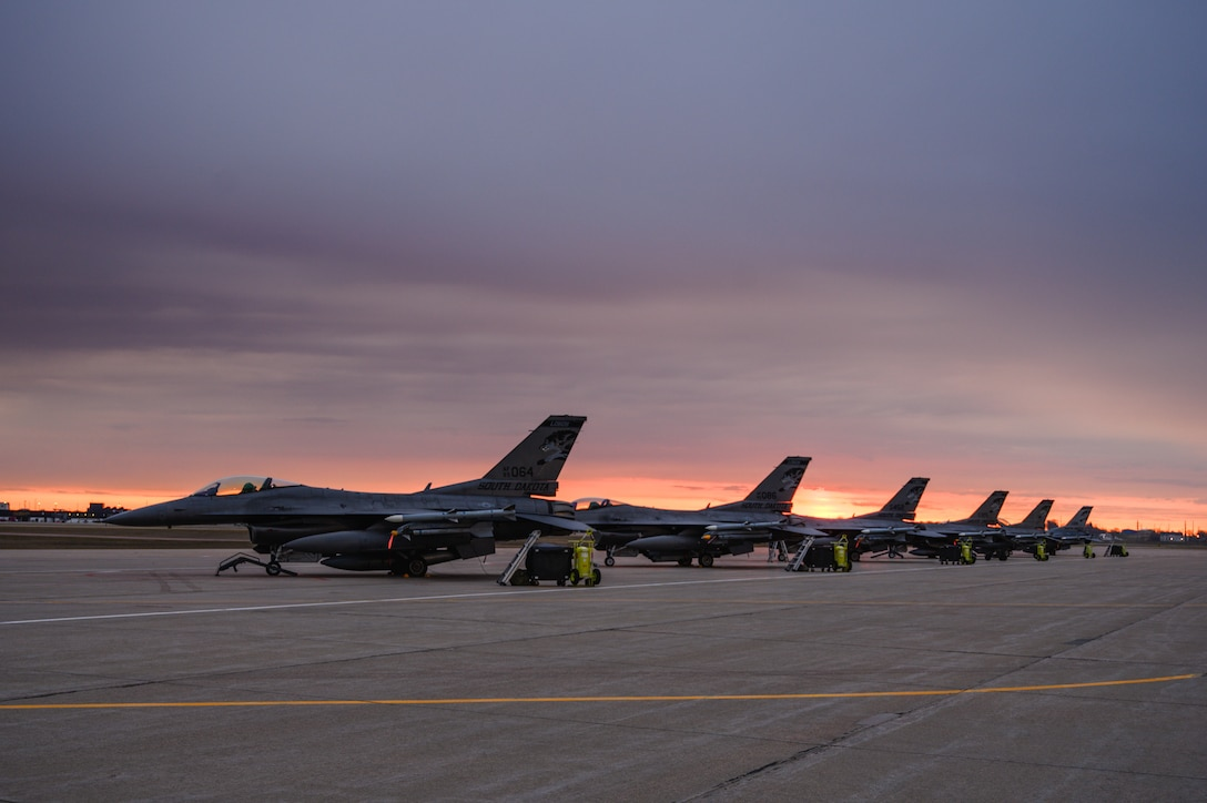 F-16 Fighting Falcons parked on the flightline