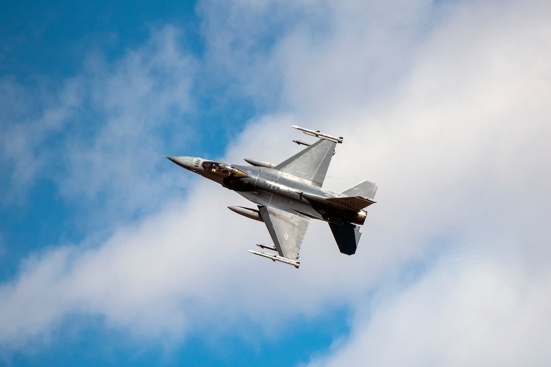 An F-16 Fighting Falcon performs a flyby maneuver