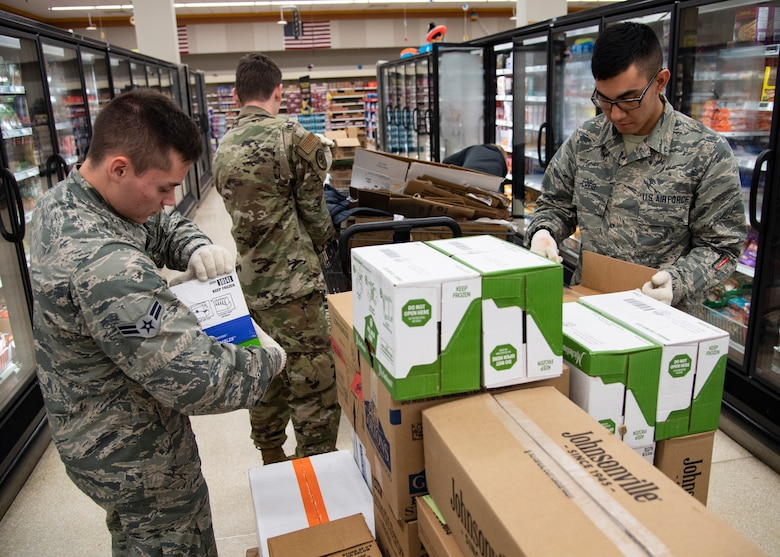 From left, Airman 1st Class Kyle Mason, Airman Bryce Jones and Airman Jackson Cribb, 362nd Training Squadron crew chief apprentice course students, help stock shelves at Sheppard Air Force Base, Texas, April 2, 2020. On March 25, 2020 all Department of Defense commissaries and other facilities were deemed mission essential. To help out those who work the hardest to supply the base, these Airmen in Training were sent from their squadrons to help with what they could. (U.S. Air Force photo by Senior Airman Pedro Tenorio)
