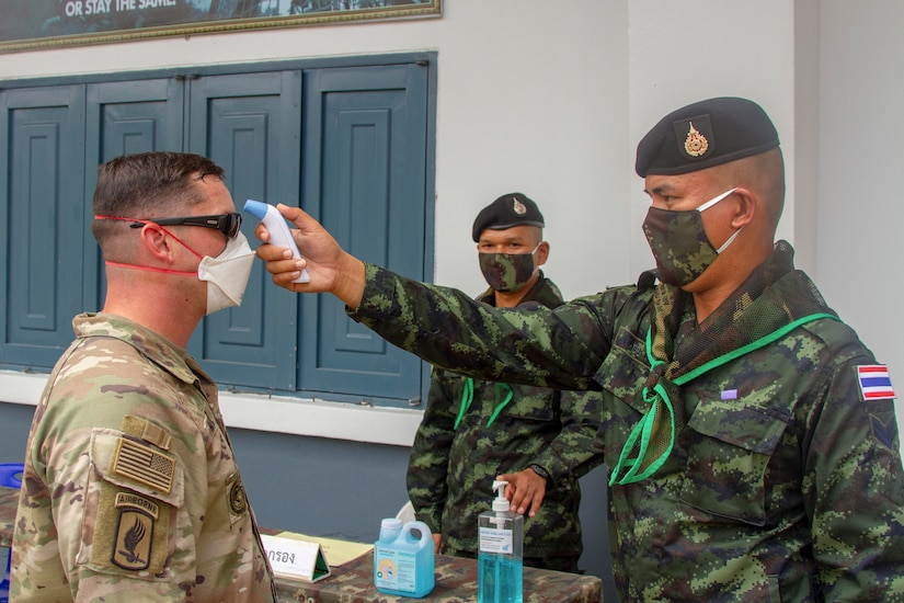 A soldier gets his temperature checked.