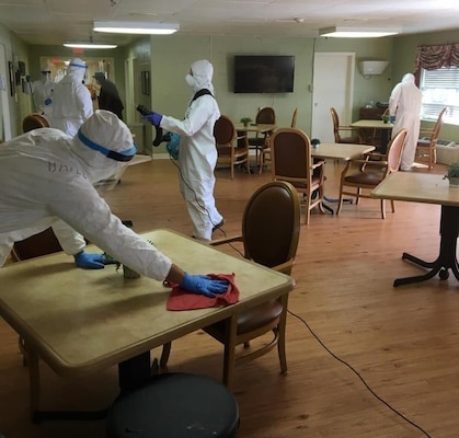Georgia Army National Guard Soldiers of the Cordele-based Company C, 2nd Battalion, 121st Infantry Regiment, disinfect common areas in a long-term care facility in Dawson, Ga., April 2, 2020.