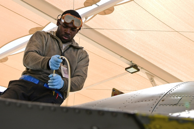 A photo of an airman working on the flight line