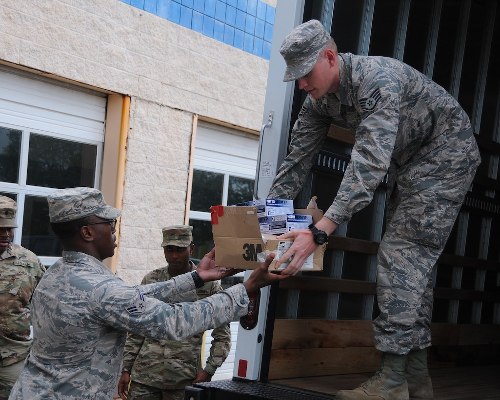 Airmen from the 186th Air Refueling Wing help unload personal protective equipment at the Bonita Lakes mobile COVID-19 testing facility, April 1, 2020, Meridian, Mississippi. Airmen and Soldiers from the Mississippi National Guard are aiding the Mississippi Department of Health and other supporting agencies to locate and stop the spread of COVID-19 around the state. (U.S. Air National Guard photo by Tech Sgt. Adam Vance)