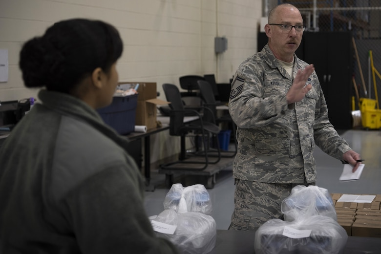 Senior Master Sgt. Michael Welch, 50th Contracting Squadron superintendent, distributes cleaning supplies at the 50th Logistics Readiness Flight warehouse at Schriever Air Force Base, Colorado, April 2, 2020. The 50th CONS secured cleaning supplies for units across the installation to fight against COVID-19. (U.S. Air Force photo by Airman 1st Class Jonathan Whitely)