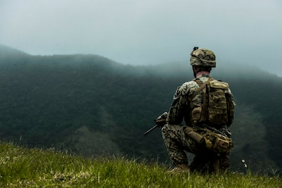 A Marine holds security during a live fire range at Central Training Area, Okinawa, Japan March 28.
