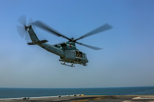 A U.S. Marine Corps UH-1Y Venom assigned to Marine Medium Tiltrotor Squadron (VMM) 365 (reinforced), 26th Marine Expeditionary Unit (MEU), departs the amphibious assault ship USS Bataan (LHD 5) during a transit through the Strait of Hormuz April 3, 2020. Bataan, with embarked 26th MEU, is deployed to the U.S. 5th Fleet area of operations in support of naval operations to ensure maritime stability and security in the Central Region, connecting the Mediterranean and Pacific through the Western Indian Ocean and three strategic choke points. (U.S. Marine Corps photo by Cpl. Gary Jayne III)