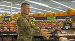 West Virginia National Guard Sgt. Davis Dean, Task Force Chemical, Biological, Radiological and Nuclear (CBRN) Response Enterprise (TF-CRE), speaks with employees of Wal-Mart during a retail training session March 31, 2020, in Nitro, West Virginia. Members of TF-CRE have been training retailers, food establishments, convenience stores and local first responders and healthcare workers in proper cargo, box handling and PPE wear in response to the COVID-19 pandemic. (U.S. Air National Guard photo by Master Sgt. Eugene Crist)