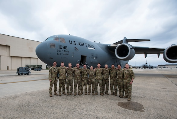Airmen assigned to Joint Base McGuire-Dix-Lakehurst, N.J., return home after a two week deployment supporting the fight against COVID-19, April 3, 2020. The Airmen were tasked with providing extra help in deployed locations following increased mission requirements due to the pandemic. The aircrew also picked up more than 970,000 swab kits from Aviano, Italy and flew them down to Memphis, Tennessee where they will be distributed to various sites to be tested for Coronavirus. (U.S. Air Force Senior Airman Ariel Owings)
