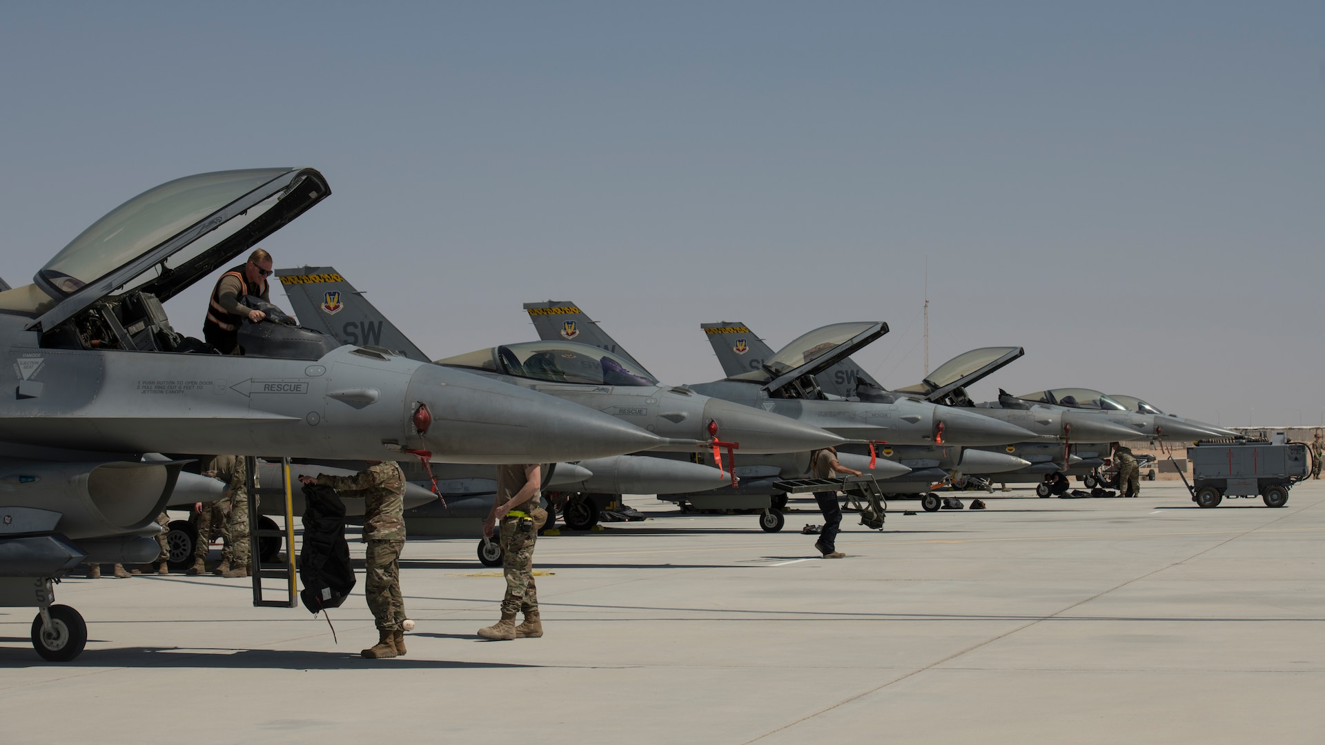"""Six U.S. Air Force F-16 """"Viper"""" Fighting Falcons assigned to the 79th Expeditionary Fighter Squadron rest on a flightline at an undisclosed location in the U.S. Central Command area of responsibility, Feb. 14, 2020."""