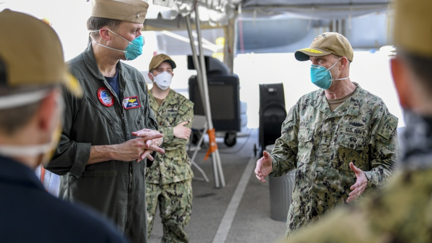 Vice Admiral Bill Merz, commander, U.S. 7th Fleet, meets with the staff and crew of the aircraft carrier USS Theodore Roosevelt (CVN 71), April 5. Merz arrived in Guam to assess and support the ongoing COVID-19 recovery efforts for the crew of Theodore Roosevelt.