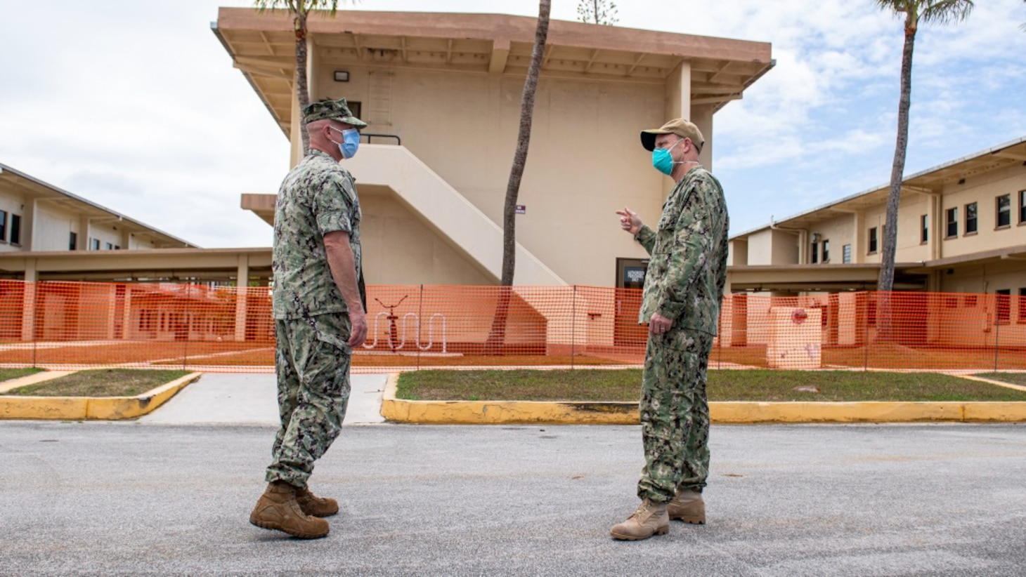 Vice Admiral Bill Merz, commander, U.S. 7th Fleet, meets with the Naval Base Guam Commanding Officer Capt. Jeffrey Grimes and Rear Adm. John Menoni, commander, Joint Region Marianas, outside of a military barracks housing Sailors from USS Theodore Roosevelt (CVN 71), April 5. Merz arrived in Guam to assess and support the ongoing COVID-19 recovery efforts for the crew of Theodore Roosevelt.