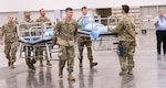 Texas Army National Guard troops set up a field hospital in response to COVID-19 April 1, 2020, at the Kay Bailey Hutchison Convention Center in Dallas. Service members across Texas worked to set up geographically separated units to support local communities.
