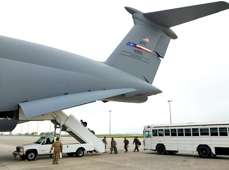 Reservists load into a C-5 Super Galaxy Aircraft to help support COVID-19 relief efforts.