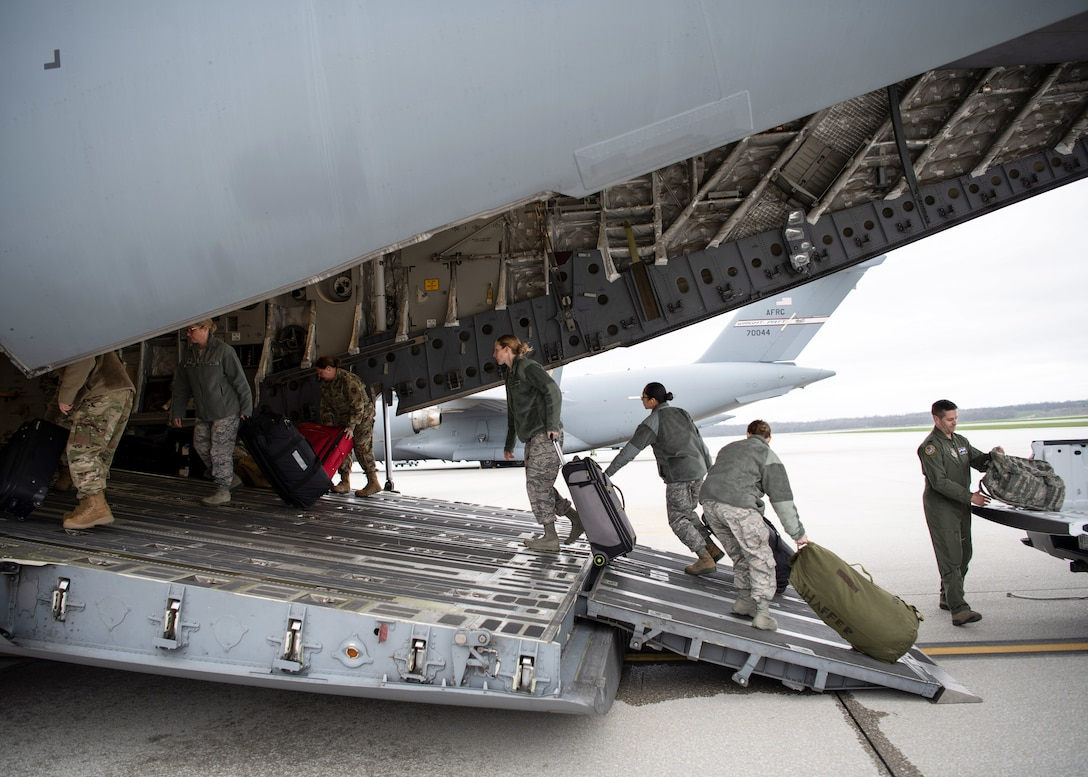 A doctor and several nurses from the 445th Airlift Wing's Aerospace Medicine and Aeromedical Staging Squadrons, board a C-17 Globemaster III here April 5, 2020 heading to Joint Base McGuire-Dix-Lakehurst. The Airmen were notified April 4, 2020 that they would be mobilized to New York City to help with the COVID-19 pandemic. The Citizen Airmen will join other military personnel providing medical services at the Jacob Javits Center in New York City. This deployment is part of a larger mobilization package of more than 120 doctors, nurses and respiratory technicians Air Force Reserve units across the nation provided over the past 48 hours in support of COVID-19 response to take care of Americans. (U.S. Air Force photo/Mr. Patrick O'Reilly)
