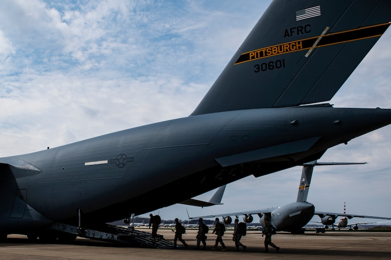 Airmen assigned to the 911th Airlift Wing who were mobilized to support the COVID-19 efforts board onto a C-17 Globemaster III aircraft at the Pittsburgh International Airport Air Reserve Station, Pennsylvania, April 5, 2020.
