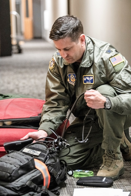 Col. Hans F. Otto, 445th Aerospace Medicine Squadron commander, checks his luggage for essential items here April 5, 2020. He and nurses from the 445th Airlift Wing's Aeromedical Staging Squadrons were notified April 4, 2020 that they would be mobilized to New York City to help with the COVID-19 pandemic. The Citizen Airmen will join other military personnel providing medical services at the Jacob Javits Center in New York City. This deployment is part of a larger mobilization package of more than 120 doctors, nurses and respiratory technicians Air Force Reserve units across the nation provided over the past 48 hours in support of COVID-19 response to take care of Americans. (U.S. Air Force photo/Mr. Patrick O'Reilly)