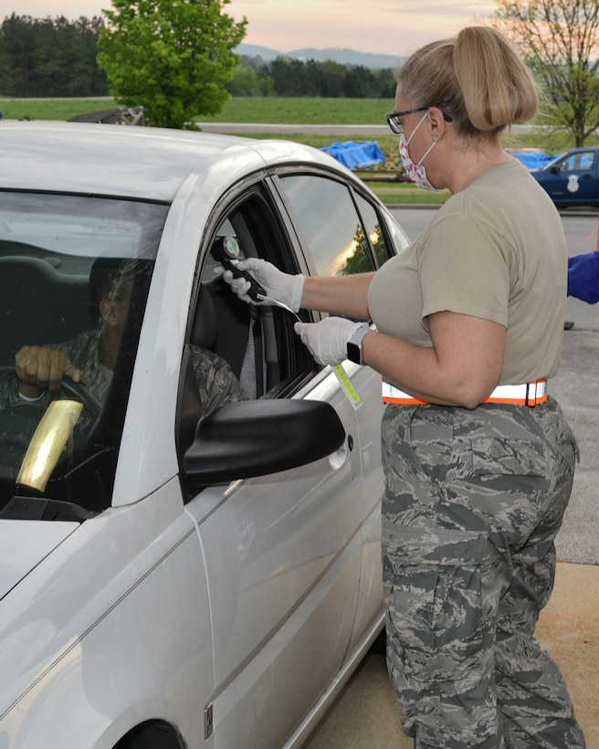 Medical staff of the 117th Air Refueling Wing Medical Group perform manditory screenings of personnel prior to entry to the 117th Air Refueling Wing, Sumpter Smith Joint National Guard Base, Birmingham, Alabama during the COVID 19 outbreak March 27, 2020. (U.S. Air National Guard photo by Ken Johnson)