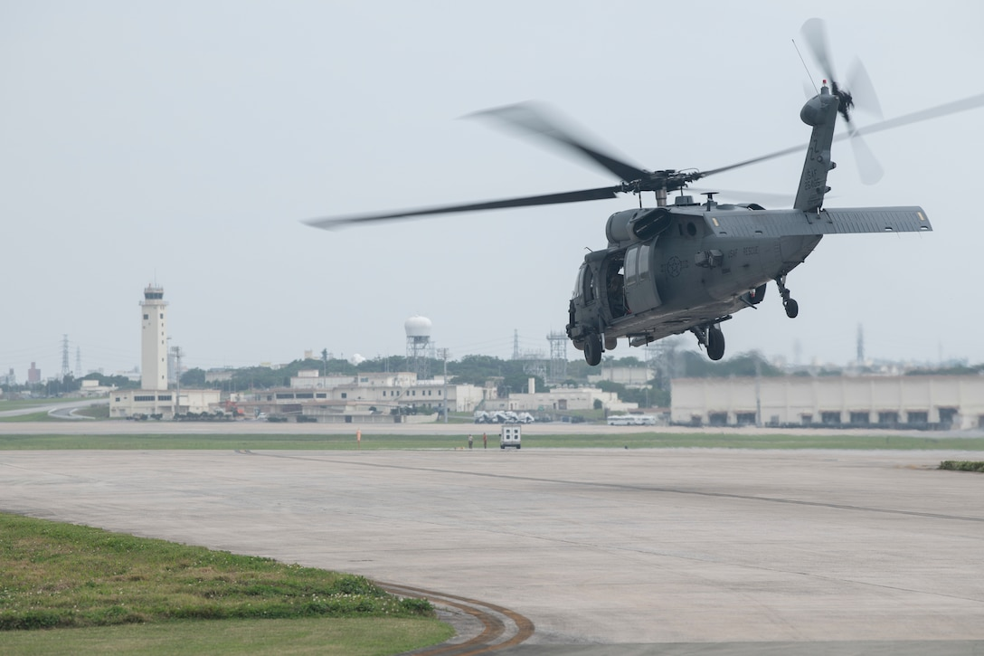A U.S. Air Force HH-60 Pave Hawk, assigned to the 33rd Rescue Squadron, lifts off April 3, 2020, at Kadena Air Base, Japan. Despite increased health protective measures, Kadena Airmen continue to maintain mission readiness in support of a free and open Indo-Pacific. The HH-60G Pave Hawk's primary function is to recover personnel in hostile conditions day and night, no matter the weather. (U.S. Air Force photo by Senior Airman Rhett Isbell)